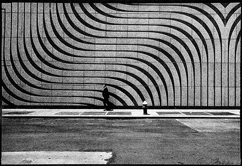 """Man with curved lines wall - Lower Manhattan"" by Len Speier - Streetscapes 2016 Photography Exhibition 1650 Gallery Best of Show"