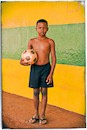 """Brazilian boy posing with soccer ball"" by Raf Willems"